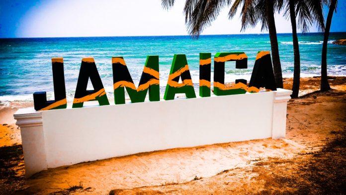 Decorative sign saying 'Jamaica' on a beach