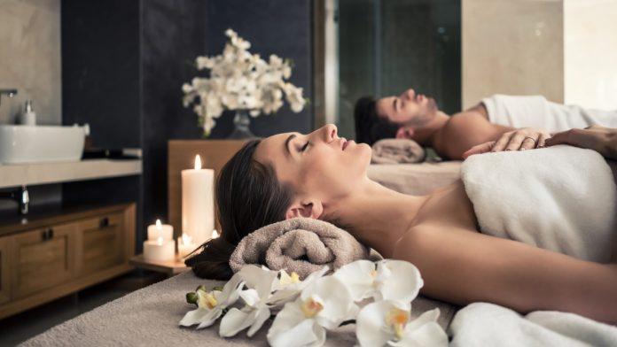 A couple receiving spa treatment